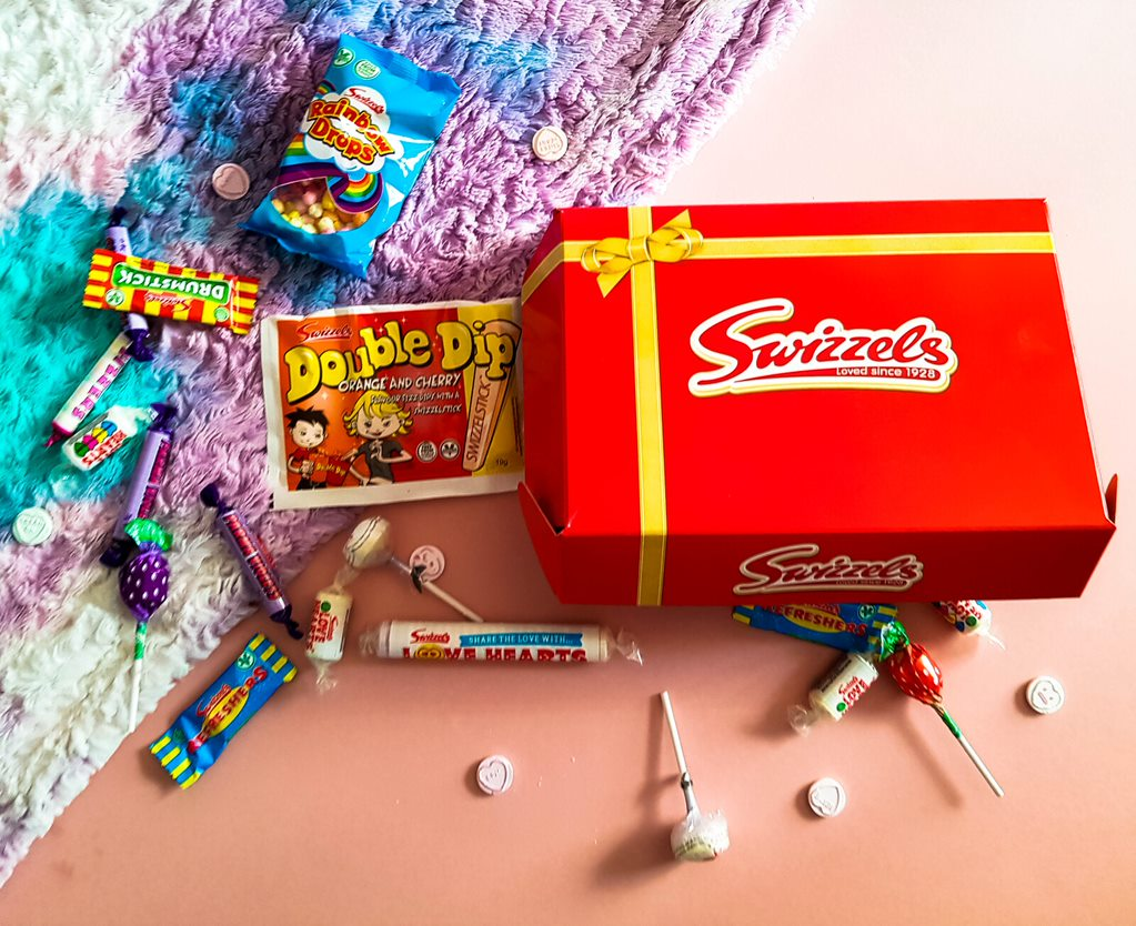 swizzels red and gold gift box with sweets spilling out